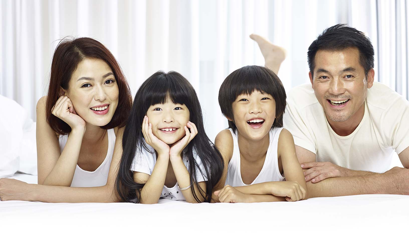 Portrait Of Asian Family With Two Children
